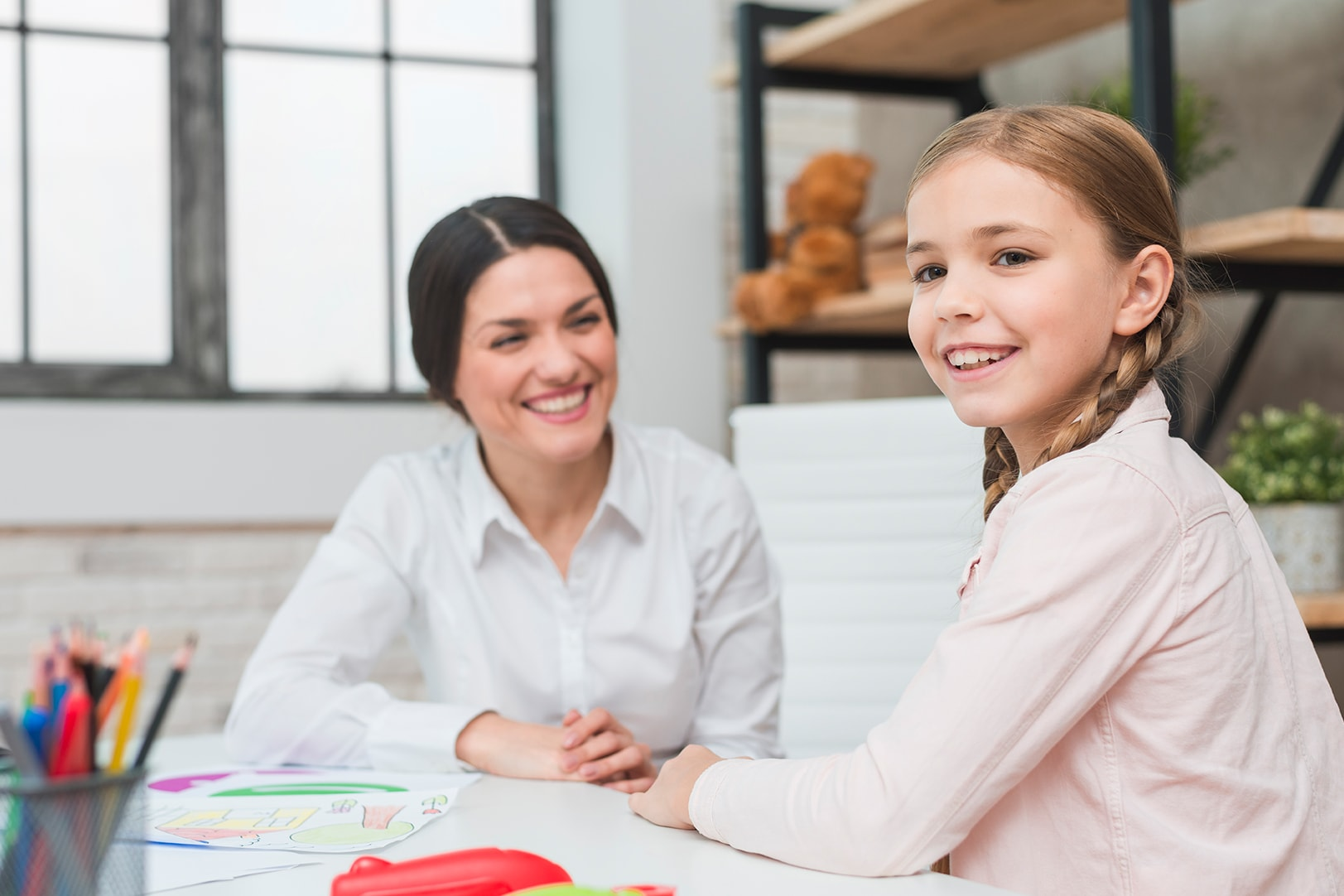 Child psychologist from Mindsight Clinic with a child for child counselling