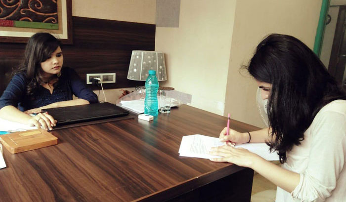 Psychologist conducting a psychological test with a client